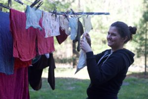 Hanging clothes out to dry instead of using dryers.